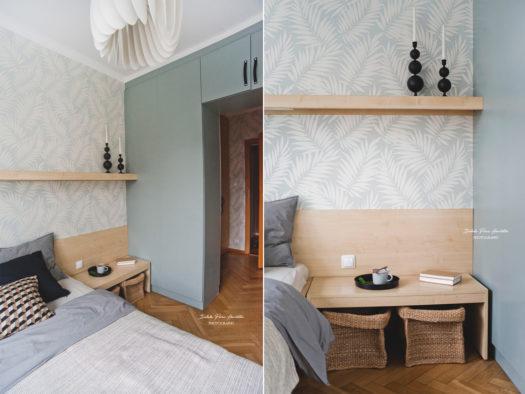 homestaging sypialni z garderobą, tapeta w liście na ścianie, szarozielona szafa, czarne dodatki